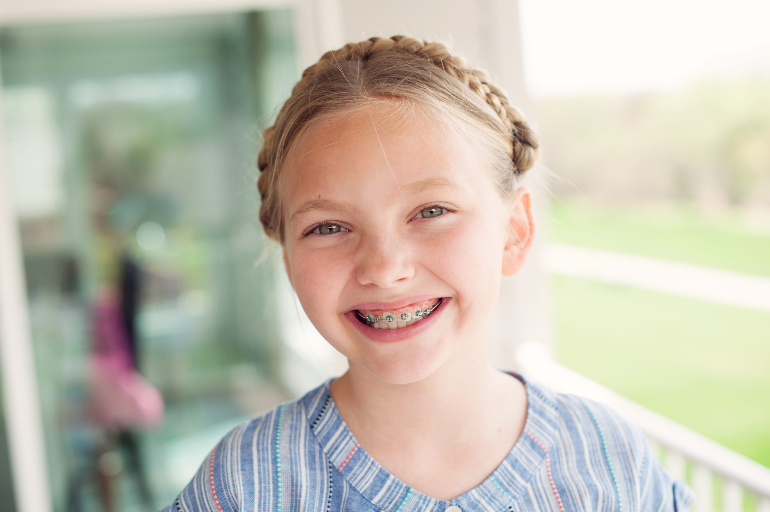 girl-smiling-after-early-orthodontic-treatment